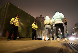 © Licensed to London News Pictures. 31/12/2020. London, UK. Police guard a boarded up Parliament Square ahead of midnight and a muted New Year's Eve in central London. Photo credit: Peter Macdiarmid/LNP