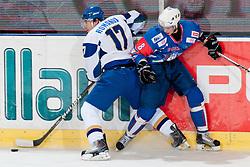 Konstantin Romanov of Kazahstan vs Ziga Jeglic of Slovenia at ice-hockey match between Slovenia and Kazahstan, on April 12, 2011 at Hala Tivoli, Ljubljana, Slovenia. (Photo By Matic Klansek Velej / Sportida.com)
