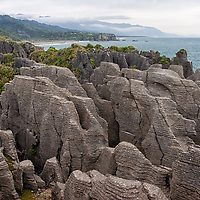 The Pancake Rocks are located south of Punakaiki village, which lies on the edge of Paparoa National Park.