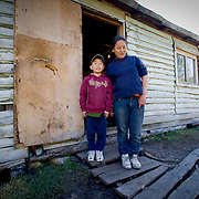 Mongolian boy and sister outside house (Gorkhi-Terelj national park, Mongolia - Sep. 2008) (Image ID: 080917-0916051a)