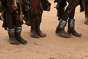 Africa, Ethiopia, Omo Valley, Karo tribesmen woman with leg bracelets