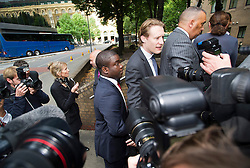 © London News Pictures. 10/09/2012. London, UK . Kweku Adoboli (centre red tie) arriving at Southwark Crown Court in London on September 10, 2012 where he is charged with charged with fraud by abuse of position and false accounting.  Adoboli is accused of undertaking unauthorised trading at Swiss bank UBS that resulted in a $2bn loss for the bank, one of the biggest ever cases of alleged unauthorised trading. Photo credit: Ben Cawthra/LNP