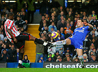 Photo: Tom Dulat/Sportsbeat Images.<br /> <br /> Chelsea v Sunderland. The FA Barclays Premiership. 08/12/2007.<br /> <br /> Dickson Etuhu of Sunderland and John Terry of Chelsea kick the ball.