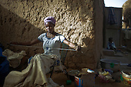 Young woman weaving, Ennde, Dogon Country, Mali.