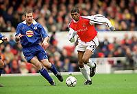 Kanu (Arsenal) Gerry Taggart (Leicester City). Arsenal 6:1 Leicester City, FA Carling Premiership, 26/12/2000. Credit Colorsport / Stuart MacFarlane.