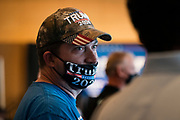 """DULUTH, MN – SEPTEMBER 9: A supporter looks on before Donald Trump, Jr.'s """"Make America Great Again"""" rally in Duluth, Minnesota on Wednesday, Sept. 9, 2020."""