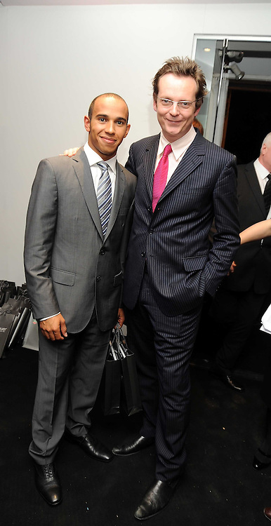 Left to right, LEWIS HAMILTON and motor journalist JASON BARLOW at the TAG Heuer British Formula 1 Party at the Mall Galleries, London on 15th September 2008.