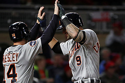 September 29, 2017 - Minneapolis, MN, USA - The Detroit Tigers' Nicholas Castellanos (9) celebrates with teammate Alex Presley (14) after hitting a two-run home run in the first inning against the Minnesota Twins on Friday, Sept. 29, 2017, at Target Field in Minneapolis. (Credit Image: © Anthony Souffle/TNS via ZUMA Wire)
