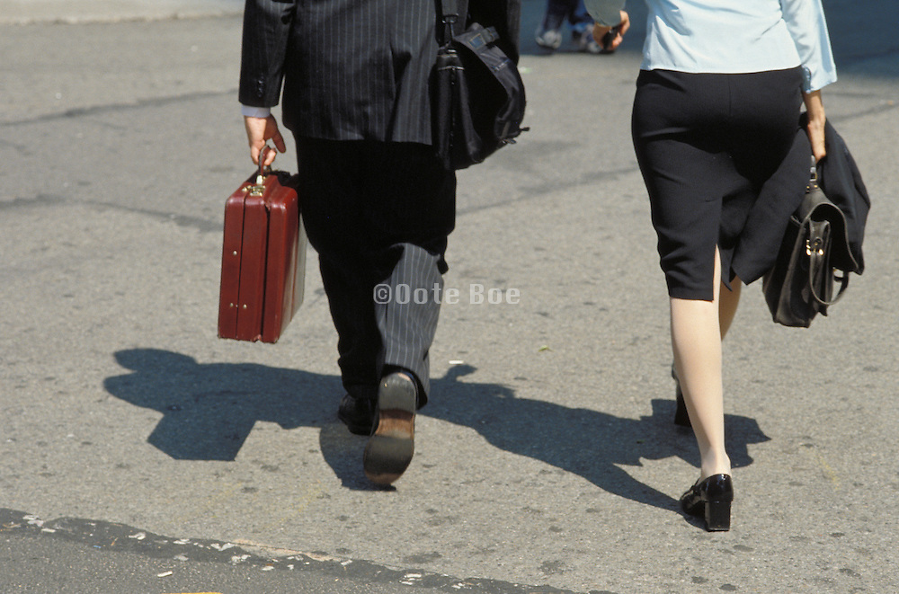 business man and woman on there way to a meeting