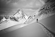 Leslie Ross ski touring above the Nordic Glacier outside of the Sorcerer's Lodge, Selkirks, Canada.