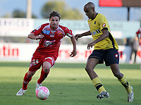 Ajaccio's midfielder Mehdi Mostefa vies with Sochaux's defender Yassin Mikari during the French L1 football match Ajaccio vs Sochaux at the Francois Coty stadium in Ajaccio, Corsica, on May 2, 2012. PHOTO PASCAL POCHARD-CASABIANCA / AFP / DPPI