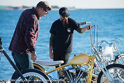 "Big Scott Stopnik with his 1949 HD Panhead ""CYCLE RAY"" talks with Ryan Grossman before the Mooneyes Yokohama Hot Rod & Custom Show. Yokohama, Japan. December 5, 2015.  Photography ©2015 Michael Lichter."