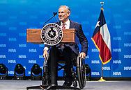 Texas Gov. Greg Abbott peaks at the NRA-ILA Leadership Forum during the NRA Annual Meeting & Exhibits on <br /> May 4, 2018 in Dallas, Texas at the Kay Bailey Hutchison Convention Center.