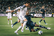 Sporting Kansas City defender Julio Cesar, right, tackles the ball away from Los Angeles Galaxy forward Juan Pablo Angel during the second half of an MLS soccer match, Saturday, May 14, 2011, in Carson, Calif. The Galaxy won 4-1. (AP Photo/Bret Hartman)