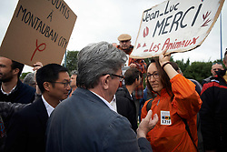 June 5, 2017 - Toulouse, France - Jean-Luc Mélechon discusses with a militant of the NGO L214 which is against animal cruelty. Jean-Luc Mélenchon (former candidate to the French Presidential Elections) , leader of the far-left movement 'France Insoumise' (ie France Unbowed), was in Toulouse to support candidates for the upcoming legislative elections. He was onboard a barge, on the Canal du Midi. He's also a candidate in Marseille. Toulouse. France. June 5th 2017. (Credit Image: © Alain Pitton/NurPhoto via ZUMA Press)