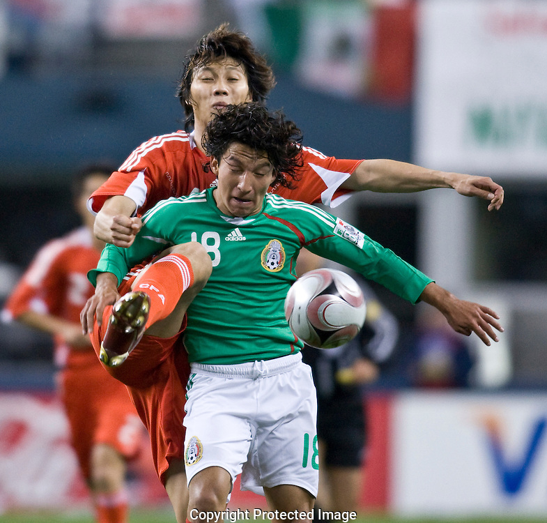 China's Mexico's during soccer game in Seattle, Wednesday, April 16, 2008. (Photo/John Froschauer) ..Mexico's China's during soccer game in Seattle, Wednesday, April 16, 2008. (Photo/John Froschauer)