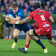 DUBLIN, IRELAND: October 16:  Garry Ringrose #13 of Leinster defended by Blade Thomson #8 of Scarlets during the Leinster V Scarlets, United Rugby Championship match at RDS Arena on October 16th, 2021 in Dublin, Ireland. (Photo by Tim Clayton/Corbis via Getty Images)