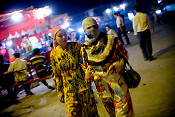 Uyghurs women make their way through night market in Yarkand, Xinjiang province in China.
