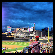 An Instagram of a hot dog vendor snapping a photo before a game at Target Field in Minneapolis, Minnesota.