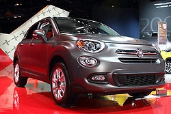"12 February 2015:  2016 FIAT 500X: On display at the 107th annual Chicago Auto Show, Feb.14-22, 2015, is the all-new 2016 Fiat 500X, the latest addition to the Fiat lineup in North America.  Arriving in the second quarter of 2015, the Fiat 500X crossover blends genuine Italian design with advanced all-wheel drive system, unmatched functionality, and performance. The 2016 Fiat 500X is available in five trim levels: Pop, Easy, Lounge, and for a more rugged look, Trekking and Trekking Plus.  On the exterior, design elements like double headlamps, a trapezoidal nose, the signature ""whiskers and logo"" face and the rounded clamshell hood pay homage to the original Cinquecento. You'll notice the Trekking and Trekking Plus models due to the unique front and rear fascia designs, and satin silver accents. The purposeful and distinct design carries through to the five-passenger interior with clever storage, body-color instrument panel, a circular cluster display and iconic door handles. Loaded with technology and convenience, the Fiat 500X is available with features like Uconnect 6.5 radio with a 6.5-inch high-resolution touchscreen and navigation, Bluetooth streaming audio, Uconnect Access Via Mobile, a 3.5-inch color thin-film transistor (TFT) cluster display, Keyless Enter-N-Go, and heated front seats and steering wheel. Buyers have their choice of the fuel-efficient, 160-horsepower 1.4-liter MultiAir Turbo engine paired with a six-speed manual transmission, or the 2.4-liter Tigershark MultiAir2 engine that produces 180 horsepower, and is paired exclusively to a nine-speed automatic transmission on all-wheel-drive and front-wheel-drive models. Interesting exterior color choices include Arancio (orange), Rosso Passione (Red Hypnotique clear coat), Verde Toscana (green metallic) and Blu Venezia (Blue metallic).<br /> <br /> First staged in 1901, the Chicago Auto Show is the largest auto show in North America and has been held more times than any other auto exposition on the contine"