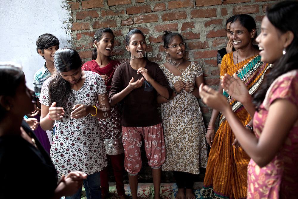 Mayuri Mahesh Pandit, 13, (centre) is participating to the Unicef-run 'Deepshikha Prerika' project inside the Milind Nagar Pipeline Area, an urban slum on the outskirts of Mumbai, Maharashtra, India, where she resides with her family.