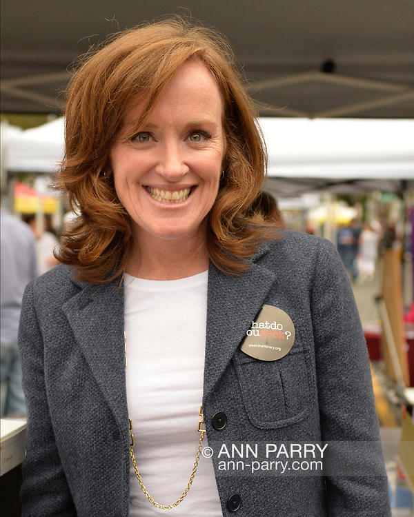 Merrick, New York, USA. 13th September 2014. Congressional candidate KATHLEEN RICE wears a 'What do you Geek?' sticker at the 23rd Annual Merrick Fall Festival & Street Fair in suburban Long Island. What do you geek? stickers, by the non-profit nonpartisan Geek the Library organization, were given out to fair visitors.