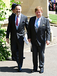 David Furnish and Elton John leave St George's Chapel at Windsor Castle after the wedding of Meghan Markle and Prince Harry.