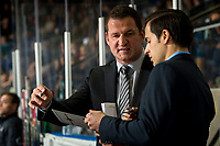 KELOWNA, CANADA - DECEMBER 7:  Kelowna Rockets' head coach Adam Foote speaks to assistant coach Travis Crickard on the bench against the Victoria Royals on December 7, 2018 at Prospera Place in Kelowna, British Columbia, Canada.  (Photo by Marissa Baecker/Shoot the Breeze)