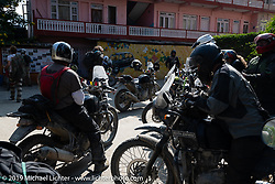 Jason Adamski of New Jersey and Led Sled's Pat Patterson leaving the Hotel Benju in Kushma after a lunch stop on Motorcycle Sherpa's Ride to the Heavens motorcycle adventure in the Himalayas of Nepal. On the sixth day of riding, we went from Tatopani to Pokhara. Saturday, November 9, 2019. Photography ©2019 Michael Lichter.