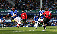 Photo: Paul Thomas.<br /> Everton v Manchester United. The Barclays Premiership. 28/04/2007.<br /> <br /> Wayne Rooney (8) scores Utd's third goal.