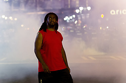 September 21, 2016 - Charlotte, North Carolina, United States of America - Sept. 21, 2016 - Charlotte, UNITED North CarolinaS - , A protestor walks away from tear gas during a protest and eventual riot in Uptown Charlotte, North Carolina, The United States, Wednesday 21 September 2016. This is the second day of violence that erupted after a police officer's fatal shooting of an African-American man Tuesday afternoon. (Credit Image: © Sean Meyers via ZUMA Wire)