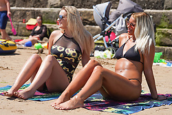 © Licensed to London News Pictures. 17/07/2021. Bridlington, UK. Stevie Severn,19 and Jessica Holmes, 21, make the most of the sunshine on Bridlington beach. Photo credit: Ioannis Alexopoulos/LNP