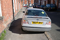 Car parked inconsiderately on the pavement restricting access for disabled people,