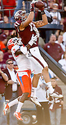 Nov 17, 2012; College Station, TX, USA;  Texas A&M Aggies wide receiver Mike Evans (13) catches a pass for a touchdown against Sam Houston State Bearkats defensive back Dax Swanson (7) during the first half at Kyle Field. Mandatory Credit: Thomas Campbell-US PRESSWIRE