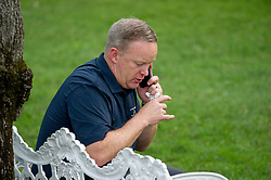 White House Press Secretary Sean Spicer has a private phone call as United States President Donald J. Trump and first lady Melania Trump host the annual Congressional Picnic on the South Lawn of the White House in Washington, DC, USA, on Thursday, June 22, 2017. Photo by Ron Sachs/CNP/ABACAPRESS.COM