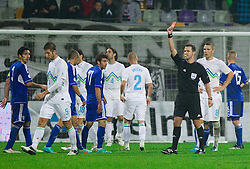 Referees Ivan Kruzliak  with red card for Bostjan Cesar of Slovenia during football match between National teams of Slovenia and Cyprus in 3rd Round of Group E of FIFA World Cup 2014 Qualification on October 12, 2012 in Stadium Ljudski vrt, Maribor, Slovenia. Slovenia defeated Cyprus 2-1. (Photo By Vid Ponikvar / Sportida)