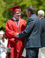 Austin Gluyas is congratulated by Principal Steve Beals as he receives his diploma during the 134th Commencement Exercise for Laconia High School Saturday morning.  (Karen Bobotas/for the Laconia Daily Sun)