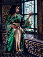 FEZ, MOROCCO - CIRCA APRIL 2017:  Young Moroccan woman dressed in traditional clothes posing by a window in the El Glaoui Palace