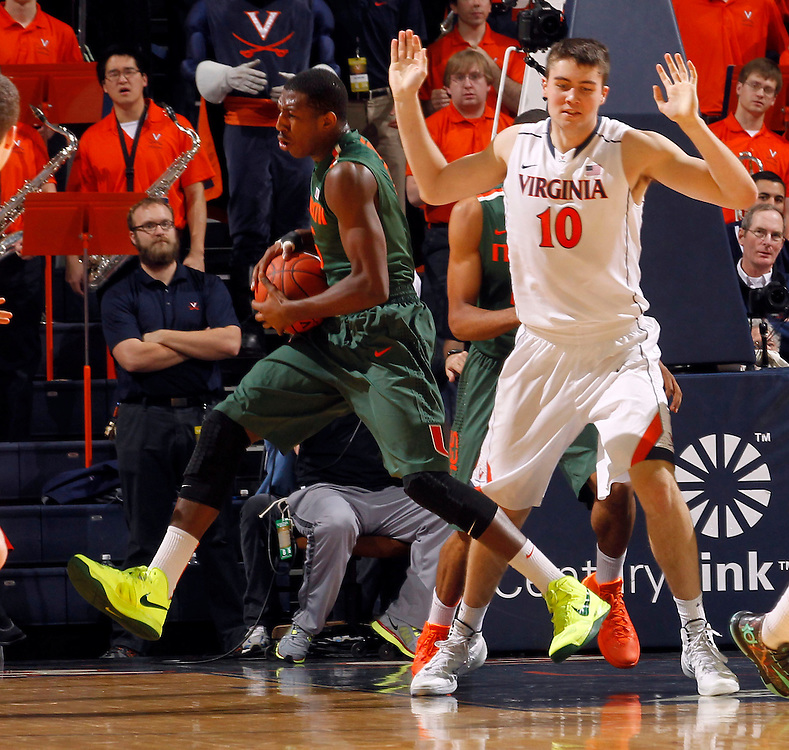 Miami guard Davon Reed (5) and Virginia forward/center Mike Tobey (10) during an NCAA basketball game Saturday Feb, 24, 2014 in Charlottesville, VA. Virginia defeated Miami 65-40.