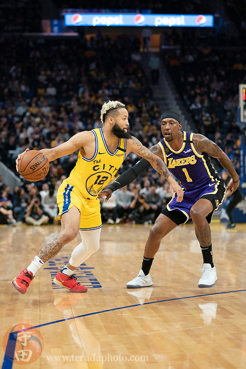 February 27, 2020; San Francisco, California, USA; Golden State Warriors guard Ky Bowman (12) dribbles the basketball against Los Angeles Lakers guard Kentavious Caldwell-Pope (1) during the fourth quarter at Chase Center.