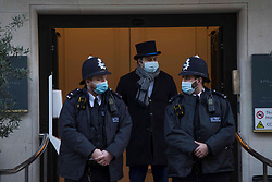 © Licensed to London News Pictures.18/02/2021. London, UK. Police guard King Edward VII Hospital in London where Duke of Edinburgh Prince Philip (99) was admitted on Tuesday night as a precaution after feeling unwell. Photo credit: Marcin Nowak/LNP