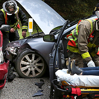 An injured driver is loaded onto an ambulance gurney after a two car crash on Coolidge Drive near Stevenson College at UC Santa Cruz Four people received non-life threatening injuries in the wreck.<br /> Photo by Shmuel Thaler <br /> shmuel_thaler@yahoo.com www.shmuelthaler.com