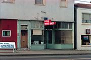 CS03045. Dick's Barber Shop, 6807 NE Union near Dekum, west side. Feb. 7, 1974