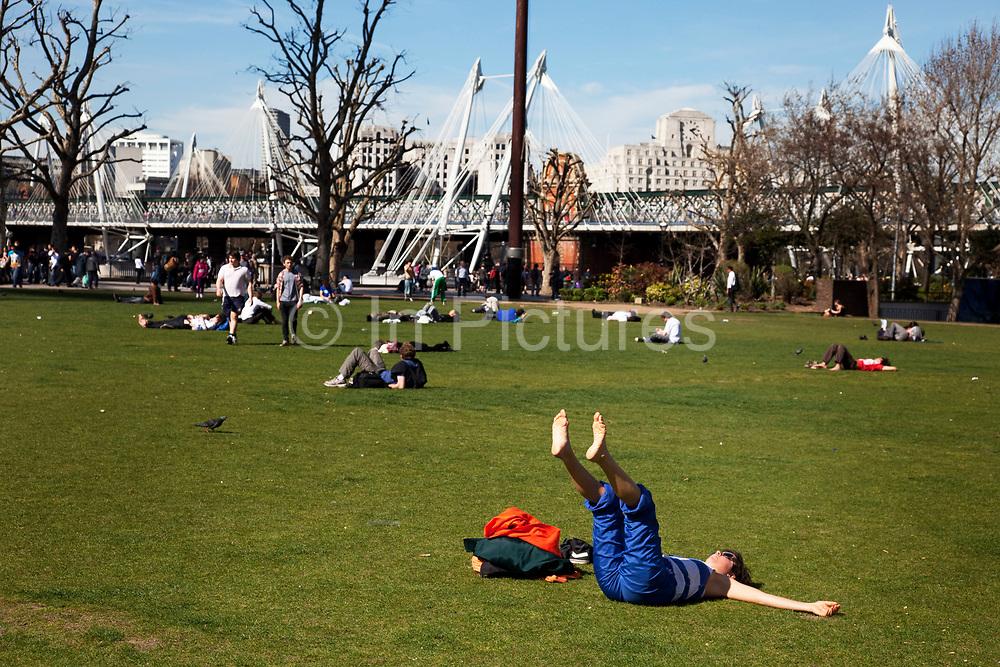 Woman exercising in the Jubilee Gardens park near Millennium Bridge in central London.