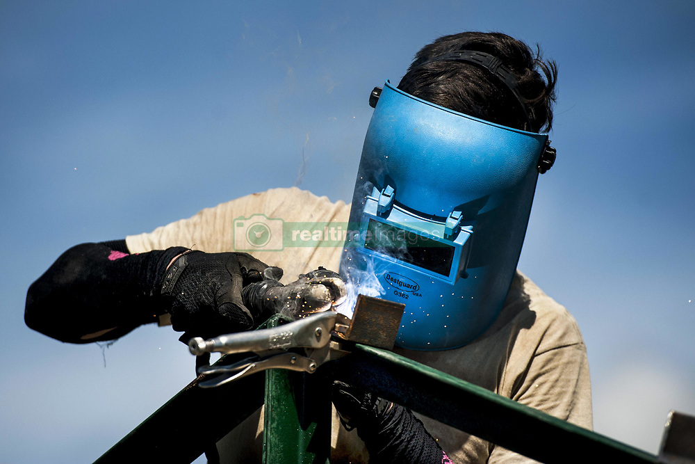 Apr 27, 2017 - Ormoc City, Philippines - Balikatan Brackets. Air Force Airman 1st Class ADRIAN WANCE welds brackets to roof-support beams during Balikatan 2017 in Ormoc City, Philippines, April 27, 2017. Balikatan is an annual U.S.-Philippine military bilateral exercise focused on humanitarian assistance, disaster relief, counterterrorism and other combined military operations. Air Force photo by Staff Sgt. Peter Reft. (Credit Image: ? Peter Reft/Air Force/DoD via ZUMA Wire/ZUMAPRESS.com)