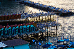 Sorrento, Italy, September 16 2017. Bathing huts on jetties at sunset in Marina Santo Francesco in Sorrento, Italy. © Paul Davey