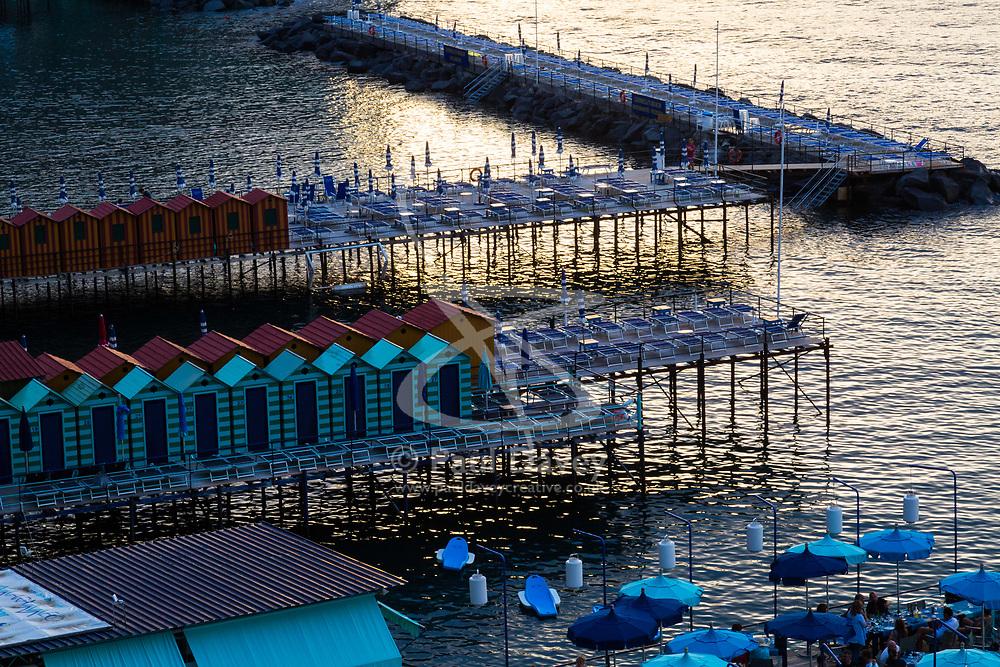 Sorrento, Italy, September 16 2017. Bathing huts on jetties at sunset in Marina Santo Francesco in Sorrento, Italy. © Paul Davey