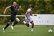 Waitakere United's Nathan Lobo and Hawke's Bay United's Bill Robertson chase down the ball in the Handa Premiership football match, Hawke's Bay United v Waitakere United, Bluewater Stadium, Napier, Sunday, December 20, 2020. Copyright photo: Kerry Marshall / www.photosport.nz