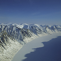 NUNAVUT, Canada. Mountains & frozen fjord on Baffin Island, north of Arctic Circle.