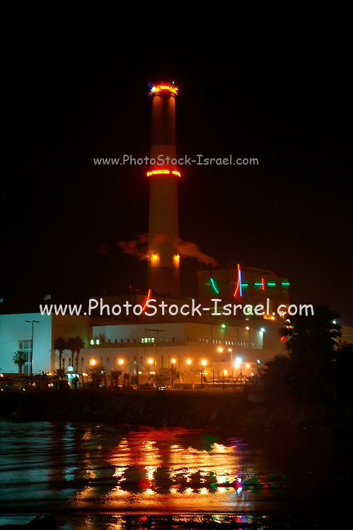 Israel, Tel Aviv, Night shot of the Reading power plant on the bank of the Yarkon river in northern Tel Aviv